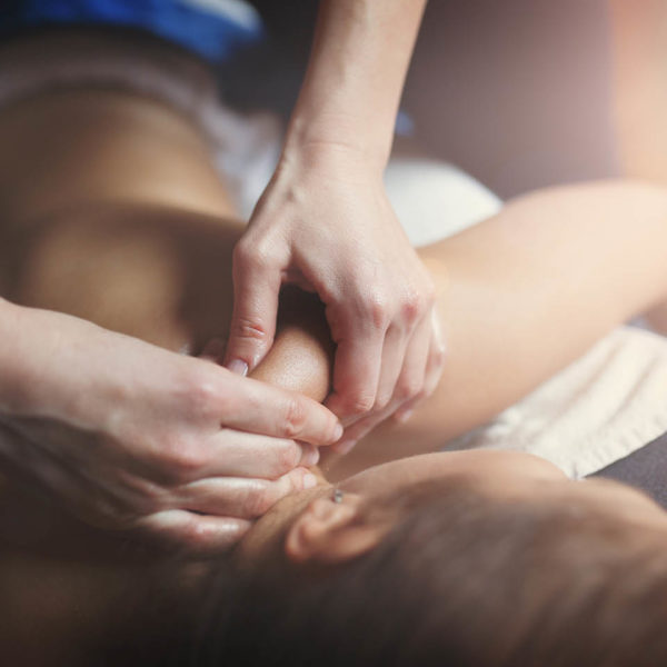 A massage therapist performing a massage on her client