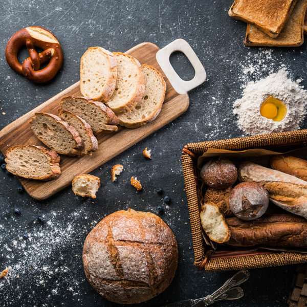 A variety of breads on a work sruface
