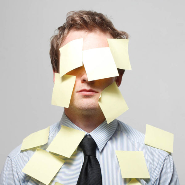 A man covered in Post-It Notes