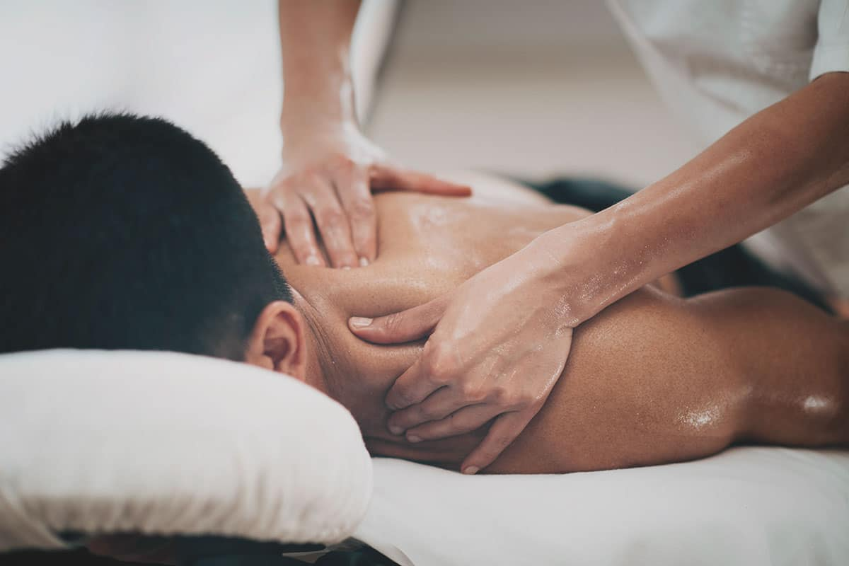 A man receiving a deep tissue massage for back pain