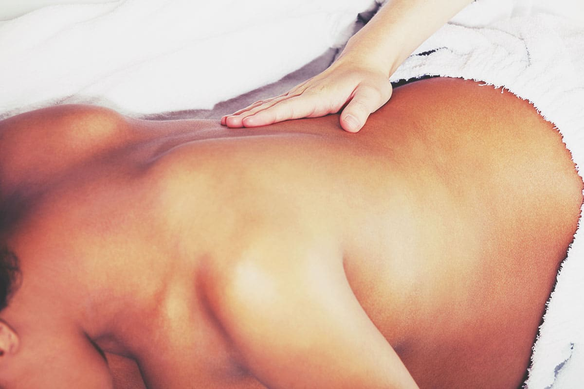 A pregnant woman receiving a pregnancy massage