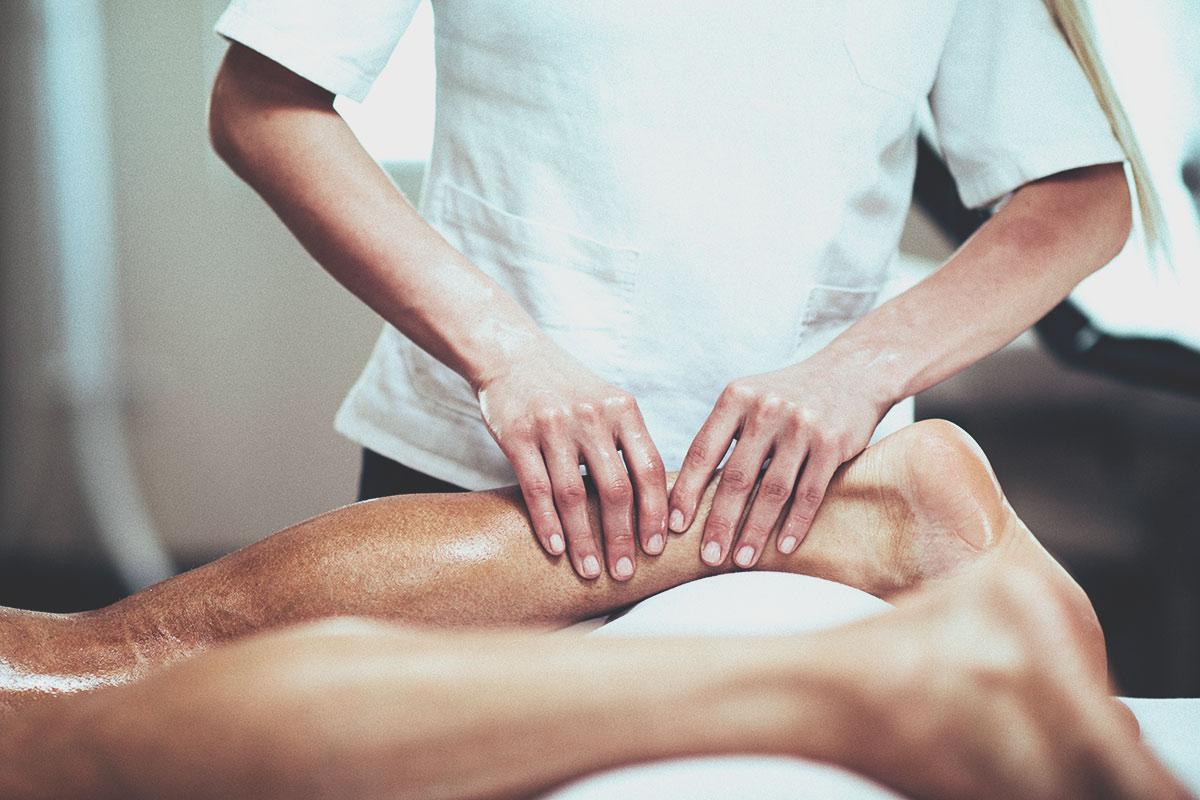 Massage therapist providing sports massage therapy