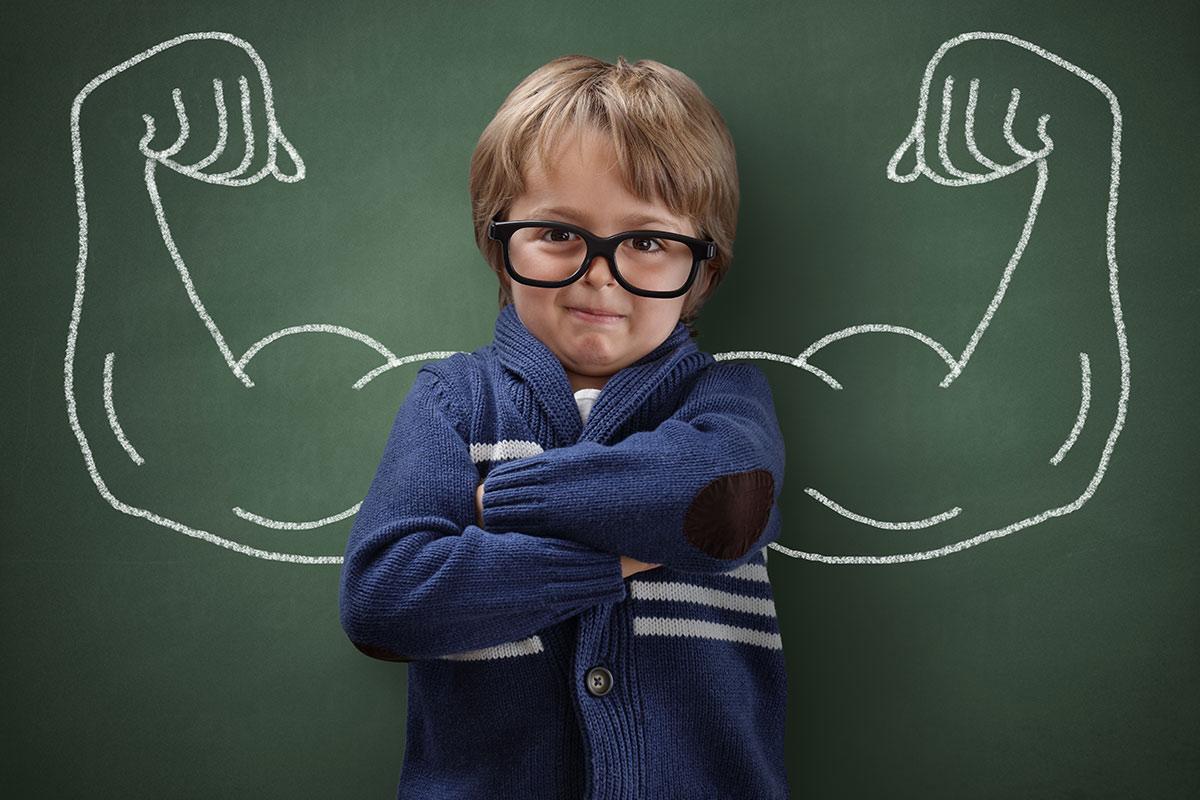 A young boy posing with a confident attitude