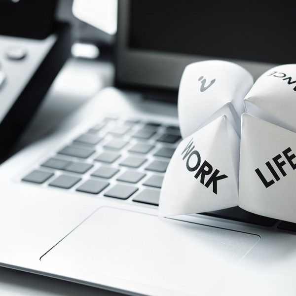 """A paper fortune-teller with the words """"Work"""" and """"Life"""" printed on it."""