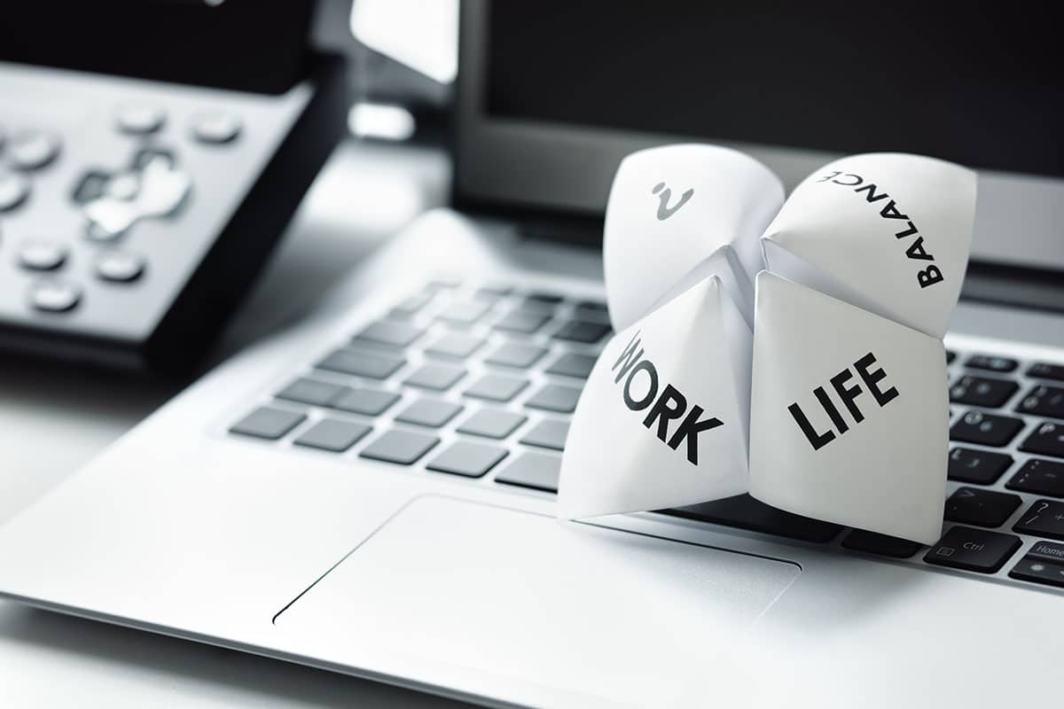 "A paper fortune-teller with the words ""Work"" and ""Life"" printed on it."
