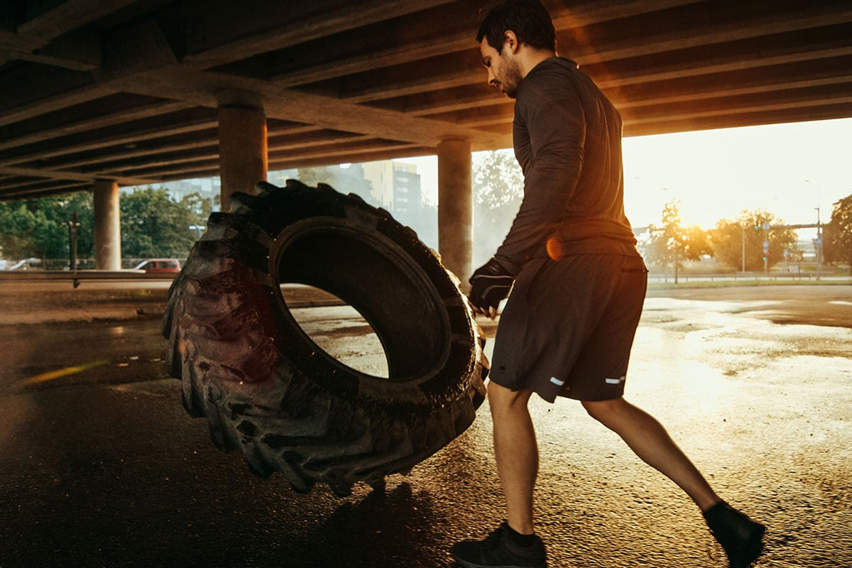 A man doing an outdoor workout early in the morning