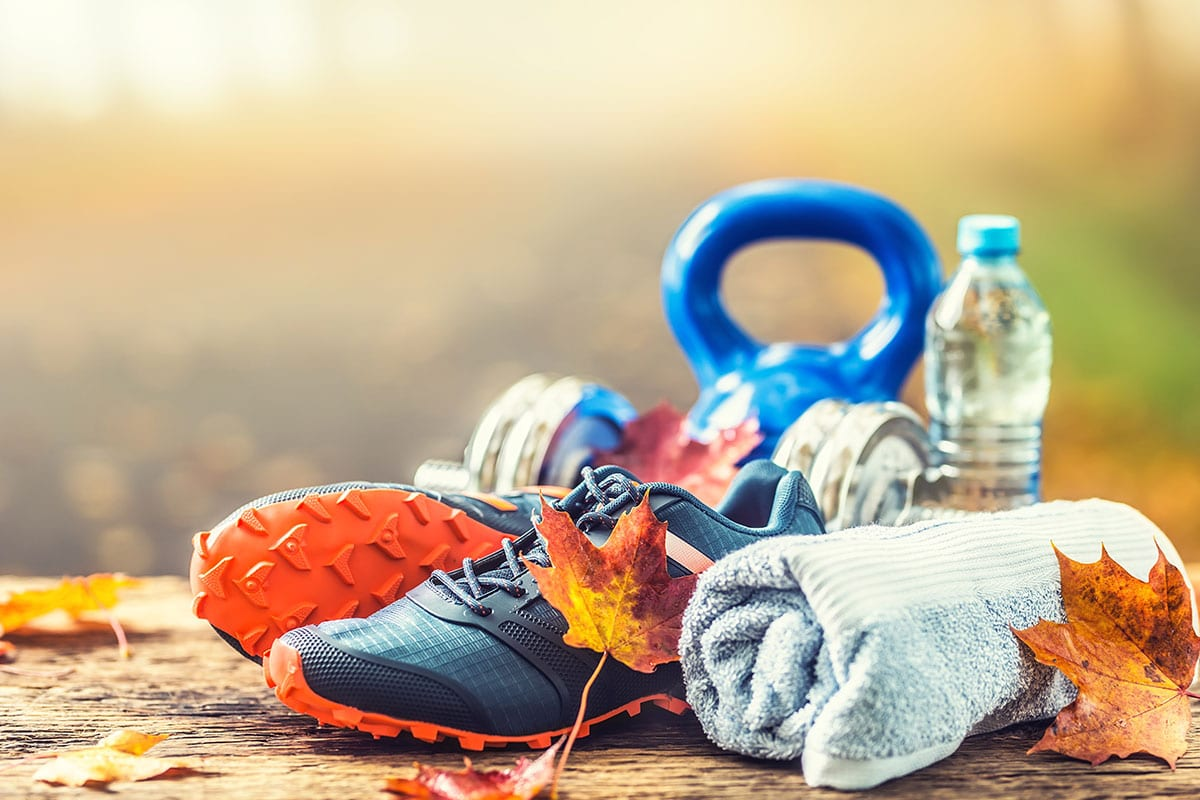 Workout gear: running shoes, kettlebell, water bottle, and towel.