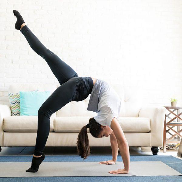 A woman doing an elaborate back-bend