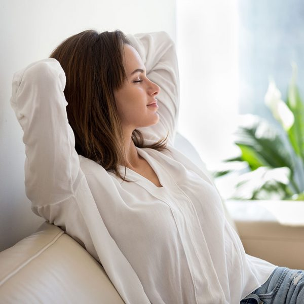 A woman relaxing on a couch.