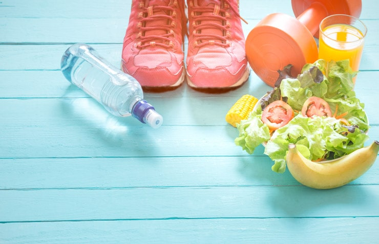 Water bottle, sneakers, a dumbbell, and a bowl of salad.